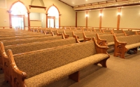 custom pews, carved wooden pew ends, padded upholstered seats