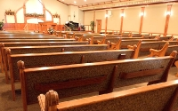 upholstered custom church seating, cloth back pews, hymnal racks