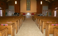 sanctuary furniture, custom pews, pulpit furniture, stained wooden backs, attached book racks