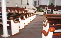 custom pews, engraved pew ends, upholstered church seating