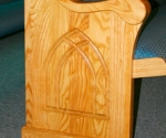 custom pew, carved wooden pew end, light wood stain