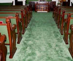 custom carved wooden sanctuary furniture, green upholstery, dark wood stained pew ends, pulpit furniture
