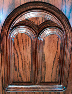 custom design carved stained wood church pew end