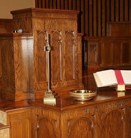 restored wooden church podium, updated sanctuary furniture