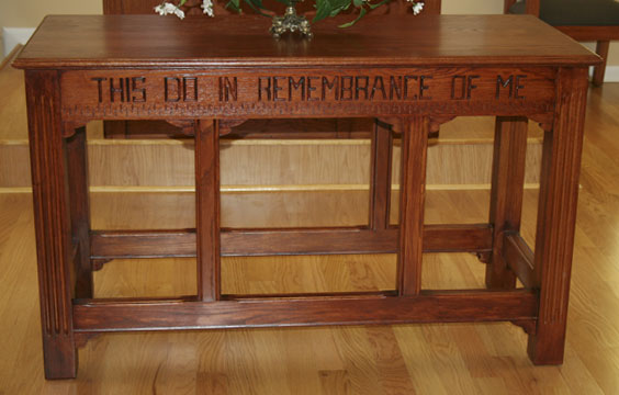custom designed communion table, stained wood, carved bible verse
