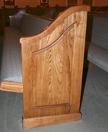 simple wood-stained pew end