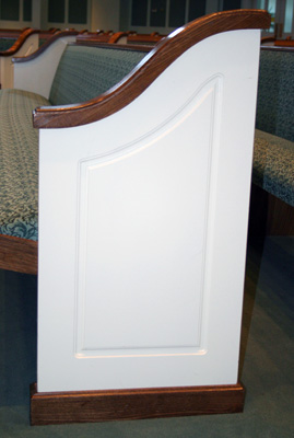 colonial style pews, white with stained wood trim custom ends, upholstered church furniture